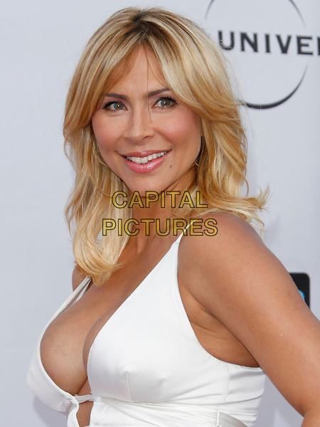 AYLIN MUJICA . arriving at the The Cable Show 2010 To Feature An Evening With NBC Universal held at  Universal Studios Hollywood in Universal City, California, USA, .May 12th, 2010..portrait headshot  white side low cut cleavage  .CAP/ROT/AMB.©Adriana M. Barraza /Roth Stock/Capital Pictures