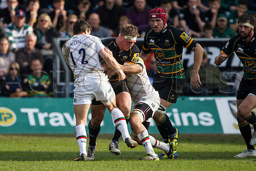 29.03.2014.  Northampton, England. Alex WALLER of Northampton Saints is tackled by Anthony ALLEN of Leicester Tigers during the Aviva Premiership match between Northampton Saints and Leicester Tigers at Franklin's Gardens.  Final score: Northampton Saints 16-22 Leicester Tigers.