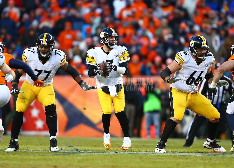 Jan 17, 2016; Denver, CO, USA; Pittsburgh Steelers offensive guard David DeCastro (66) and offensive tackle Marcus Gilbert (77) block for quarterback Ben Roethlisberger (7) against the Denver Broncos during the AFC Divisional round playoff game at Sports Authority Field at Mile High. Mandatory Credit: Mark J. Rebilas-USA TODAY Sports