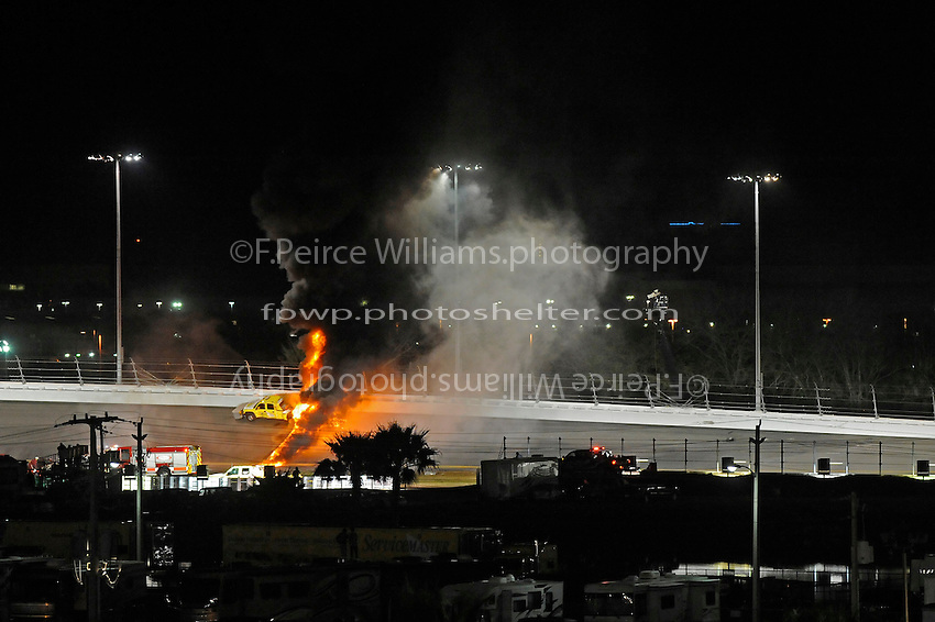 The track in turn 3 burns after a track dryer was struck by driver Juan Pablo Montoya (#42) during a caution period. The race was delayed for nearly 2 hours during the clean-up and repair.