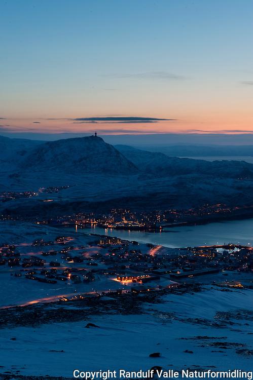 Utsikt fra Storfjellet mot Hammerfest by, Tyven, Sørøysundet og Seiland. ---- Hammerfest by mid day in december.