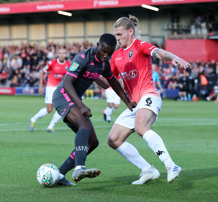 Leeds United's Edward Nketiah takes on Salford City's Carl Piergianni<br /> <br /> Photographer Alex Dodd/CameraSport<br /> <br /> The Carabao Cup First Round - Salford City v Leeds United - Tuesday 13th August 2019 - Moor Lane - Salford<br />  <br /> World Copyright © 2019 CameraSport. All rights reserved. 43 Linden Ave. Countesthorpe. Leicester. England. LE8 5PG - Tel: +44 (0) 116 277 4147 - admin@camerasport.com - www.camerasport.com