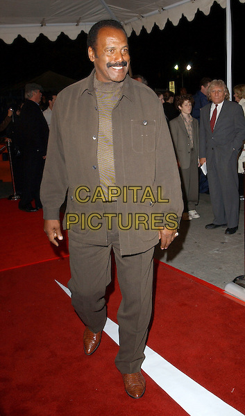 FRED WILLIAMSON.World Premiere of Warner Brother's Starsky & Hutch held at The Mann Village Theatre in Westwood, California .26 February 2004 .*UK Sales Only*.full length, full-length, brown suit.www.capitalpictures.com.sales@capitalpictures.com.©Capital Pictures..