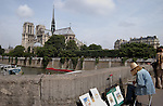 Lady artist painting the Cathedral of Notre-Dame and the river Seine. Paris France.