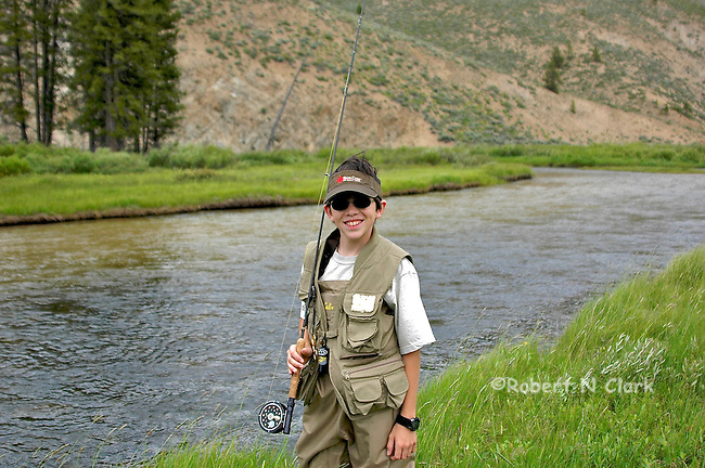 Young flyfisherman on Valley Creek near Stanley, Idaho