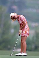 Judy Rankin putting at the Carlton, a golf tournament on the LPGA Tour played at the Calabasas Country Club, Calabasas, California, September 1976. Photo by John G. Zimmerman.