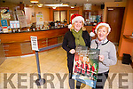 Abbeyfeale - l-r  Mairead Collins and Margaret Collins from Abbeyfeale Credit Union wishing everybody a very Happy Christmas