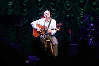 James taylor performing the John Paul Jones arena at the University of Virginia in Charlottesville, VA. 8-17-06. Photo/Andrew Shurtleff
