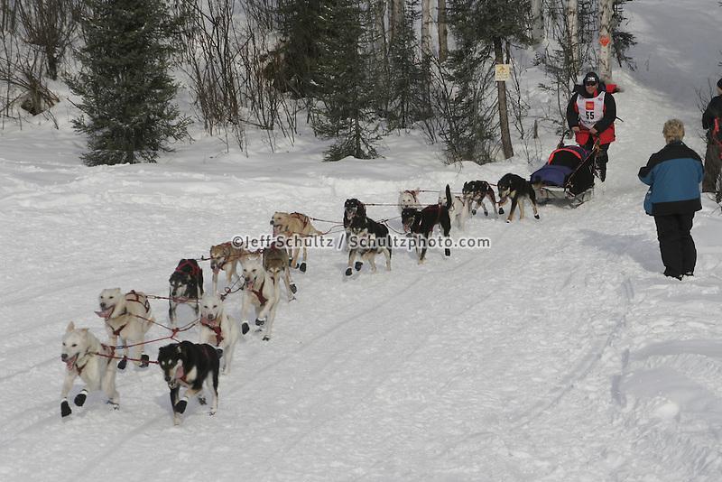 runs onto Long Lake during the Sunday restart at Willow, Alaska