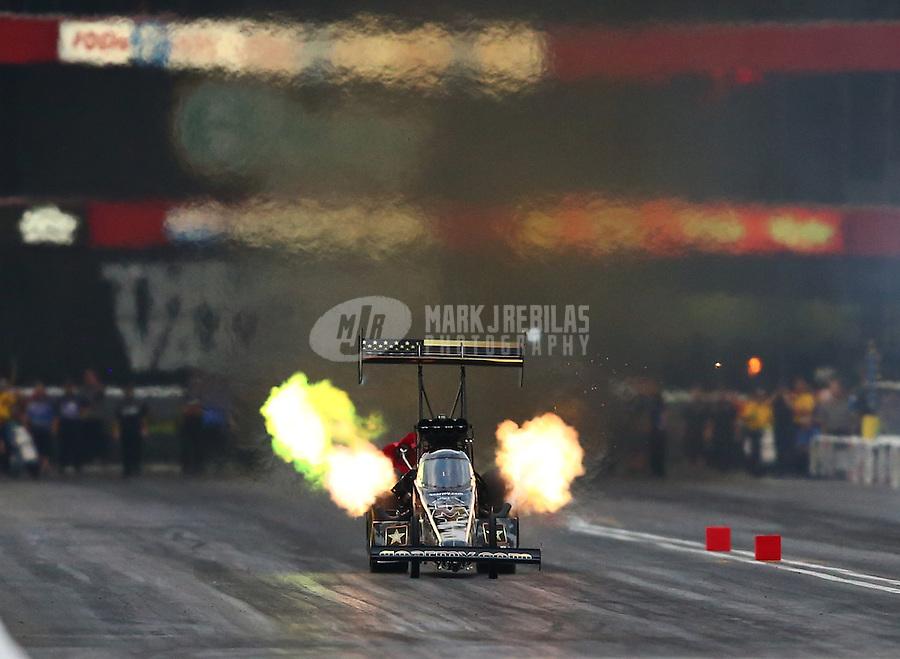 Jun 20, 2015; Bristol, TN, USA; NHRA top fuel driver Tony Schumacher during qualifying for the Thunder Valley Nationals at Bristol Dragway. Mandatory Credit: Mark J. Rebilas-USA TODAY Sports
