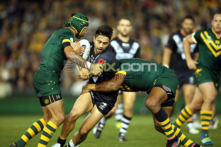 Shaun Johnson tackled by Greg Inglis and Johnathan Thurston<br /> Trans Tasman NZRL Kiwis v Australia Test Match at Hunter Stadium, Newcastle, Australia. Friday 6 May 2016. Photo: Paul Seiser / www.photosport.nz / SWpix.com