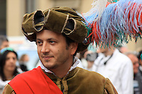 A Florentine reenactor is dressed in renaissance attire during  a city celebration.