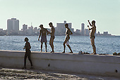 Teenagers hang out on the Malecon, the Havana sea-front.
