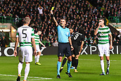 12th September 2017, Glasgow, Scotland; Champions League football, Glasgow Celtic versus Paris Saint Germain;  Daniele Orsato (ref)gives a yellow card to Simunovic