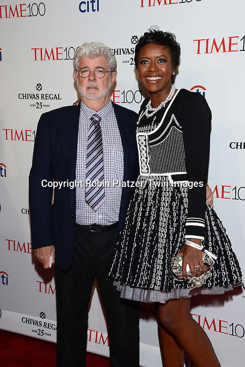 George Lucas and wife Mellody Hobson attend the TIME 100 Issue celebrating the 100 Most Influential People in the World on April 21, 2015 <br /> at Frederick P Rose Hall at Lincoln Center in New York City, New York, USA.<br /> <br /> photo by Robin Platzer/Twin Images<br />  <br /> phone number 212-935-0770