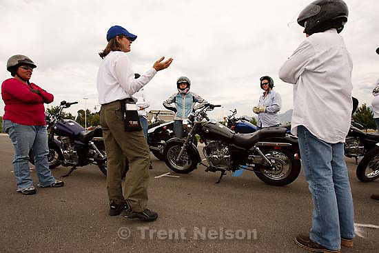 West Jordan - Laura Barnard (in blue baseball cap) teaching a motorcycle basic rider course put on by Motorcycle Rider Training at Salt Lake Community College's Jordan campus Saturday, August 29 2009. Left to right: Rhonda Grip, Laura Barnard, Lindsey Burros, Susan Douglas, Jo Ann Bartlett.