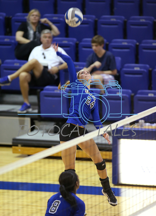Marymount's Emilleigh Rettig hits during a college volleyball match at Washington & Lee University Lexington, Vir., on Saturday, Oct. 5, 2013.<br /> Photo by Cathleen Allison