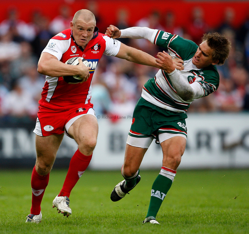 Photo: Richard Lane/Richard Lane Photography. Gloucester Rugby v Leicester Tigers. Guinness Premiership. 07/09/2008. Gloucester's Mike Tindall is tackled by Tigers' Toby Flood.