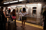 Commuters waiting on the A train on June 23, 2012.