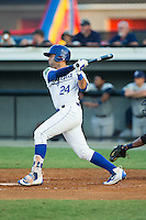 Emmanuel Rivera (24) of the Burlington Royals follows through on his swing against the Princeton Rays at Burlington Athletic Stadium on June 24, 2016 in Burlington, North Carolina.  The Rays defeated the Royals 16-2.  (Brian Westerholt/Four Seam Images)