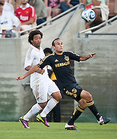 LOS ANGELES, CA – July 16, 2011: Marcelo (12) of Real Madrid and Landon Donovan (10) of the LA Galaxy during the match between LA Galaxy and Real Madrid at the Los Angeles Memorial Coliseum in Los Angeles, California. Final score Real Madrid 4, LA Galaxy 1.