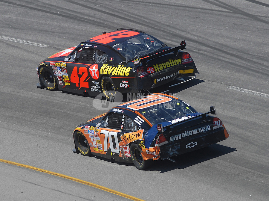 May 6, 2007; Richmond, VA, USA; Nascar Nextel Cup Series driver Juan Pablo Montoya (42) races alongside Johnny Sauter (70) during the Jim Stewart 400 at Richmond International Raceway. Mandatory Credit: Mark J. Rebilas-US PRESSWIRE Copyright © 2007 Mark J. Rebilas..