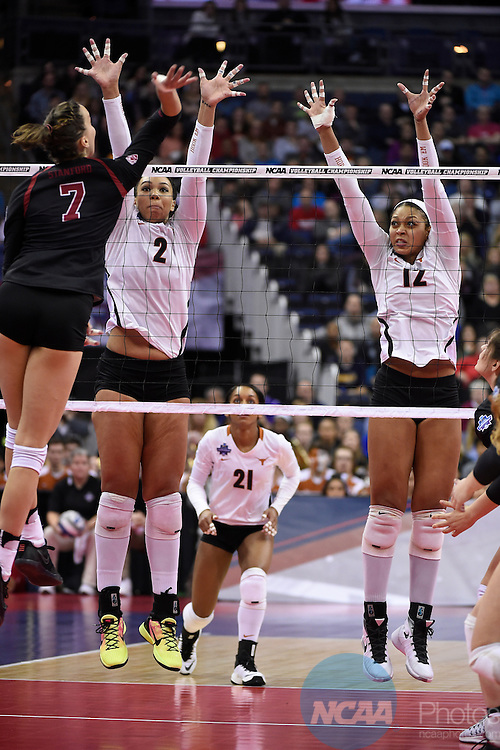 COLUMBUS, OH - DECEMBER 17:  Morgan Johnson (12) and Ebony Nwanebu (2) of the University of Texas jump for a block against Stanford University during the Division I Women's Volleyball Championship held at Nationwide Arena on December 17, 2016 in Columbus, Ohio.  Stanford defeated Texas 3-1 to win the national title. (Photo by Jamie Schwaberow/NCAA Photos via Getty Images)