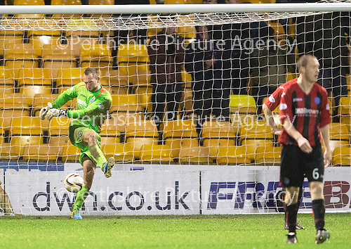 Motherwell v St Johnstone.....01.01.14   SPFL<br /> An angry and frustrated Alan Mannus boots the ball out of the net after saints conceeded the fourth goal<br /> Picture by Graeme Hart.<br /> Copyright Perthshire Picture Agency<br /> Tel: 01738 623350  Mobile: 07990 594431