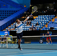 3rd January 2020; RAC Arena, Perth, Western Australia; ATP Cup Australia, Perth, Day 1,; USA v Norway Austin Krajicek of the USA plays a backhand volley at the net during the doubles against team Norway - Editorial Use