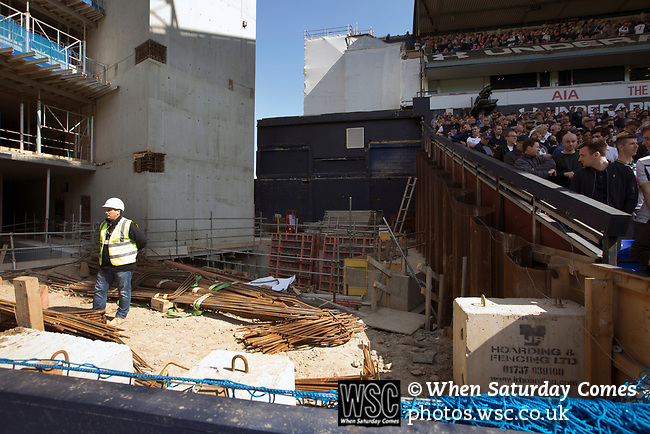 Tottenham Hotspur 4 Watford 0, 08/04/2017. White Hart Lane, Premier League. A workman in the site between the partly-demolished East Stand and the North Stand watching on as Tottenham Hotspur took on Watford in an English Premier League match at White Hart Lane. Spurs were due to make an announcement in April 2016 regarding when they would move out of their historic home and relocate to Wembley as their new stadium was completed. Spurs won this match 4-0 watched by a crowd of 31,706, a reduced attendance figure due to the ongoing ground redevelopment. Photo by Colin McPherson.
