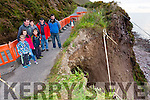 The O'Sullivan children Tadhg, Eadaoin and Paddy who have to walk to school as their road is closed after a landslide with back: Stephen, Linda, Timmy and Jerry O'Sullivan