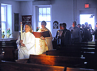 HILLTOWN, PA - APRIL 19:  Bobbie Livesey (L) holds a candle as she leads the procession into church followed by Rev. Catherine D. Kerr along with congregation members during the Holy Saturday Easter Vigil and Holy Eucharist at Good Shepherd Episcopal Church April 19, 2014 in Hilltown, Pennsylvania.  (Photo by William Thomas Cain/Cain Images)