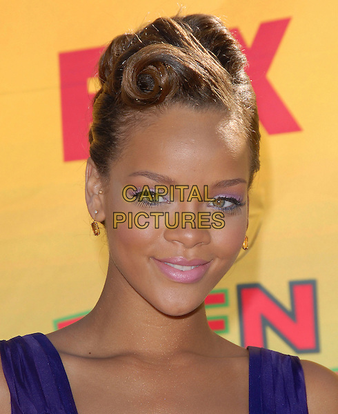 RIHANNA.At The 2006 Teen Choice Awards - Arrivals, .held at The Universal Ampitheatre in Universal City, California, USA, August 20th 2006..portrait headshot curled hair up forties style sculpted curls.Ref: DVS.www.capitalpictures.com.sales@capitalpictures.com.©Debbie VanStory/Capital Pictures