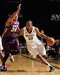 Reno Bighorns Terrance Thomas drives past Los Angeles D-Fenders' Zach Andrews during the men's basketball game in Reno, Nev., on Friday, Jan. 6, 2012. The D-Fenders won 109-78..Photo by Cathleen Allison
