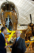 Chantilly, VA - December 11, 2003 -- Brigadier General Paul W. Tibbets (United States Air Force - retired), right,  stands in front of the Enola Gay, the B-29 aircraft he piloted on August 6, 1945 that dropped the first atomic bomb on Hiroshima, Japan at the Steven F. Udvar-Hazy Center dedication in Chantilly, Virginia on December 11, 2003.  He is talking with Bertrand Piccard, left, of Lausanne, Switzerland, left, who was the first  to circumnavigate the globe in a balloon,  March 1 - 21, 1999..Credit: Ron Sachs / CNP.(RESTRICTION: NO New York or New Jersey Newspapers or newspapers within a 75 mile radius of New York City)