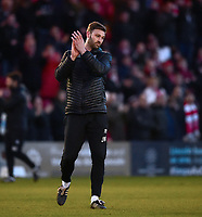 Lincoln City's first team coach/under 23 manager Jamie McCombe applauds the fans at the final whistle<br /> <br /> Photographer Andrew Vaughan/CameraSport<br /> <br /> The EFL Sky Bet League Two - Lincoln City v Northampton Town - Saturday 9th February 2019 - Sincil Bank - Lincoln<br /> <br /> World Copyright &copy; 2019 CameraSport. All rights reserved. 43 Linden Ave. Countesthorpe. Leicester. England. LE8 5PG - Tel: +44 (0) 116 277 4147 - admin@camerasport.com - www.camerasport.com