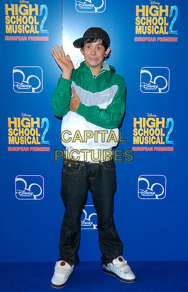 "LIL' CHRIS.Attends the European Premiere of Disney's ""High School Musical 2"" at the O2 Centre, Greenwich, London, England, September 2nd 2007. .full length lil little cap hat green and white top jeans trainers hand arm funny.CAP/CAN.©Can Nguyen/Capital Pictures"