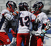 Brady Strough #12, center, gets congratulated by teammates Teddy Bentley #18, left, and Will Giarraputo #33 after scoring a goal in the Nassau County varsity boys lacrosse Class C semifinals against Floral Park at Shuart Stadium, located on the campus Hofstra University in Hempstead, on Thursday, May 24, 2018.
