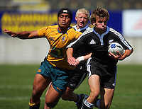 Rhys Llewellyn beats Ale Kotoni during the International rugby match between New Zealand Secondary Schools and Suncorp Australia Secondary Schools at Yarrows Stadium, New Plymouth, New Zealand on Friday, 10 October 2008. Photo: Dave Lintott / lintottphoto.co.nz