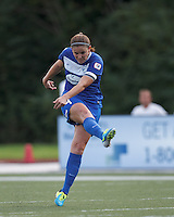 Boston Breakers defender Cat Whitehill (4) follows through on a shot.  In a National Women's Soccer League (NWSL) match, Boston Breakers (blue) tied Western New York Flash (white), 2-2, at Dilboy Stadium on August 3, 2013.