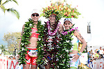 KAILUA-KONA, HI - OCTOBER 13:  (L-R) Caroline Steffan of Switzerland (2nd),  Leanda Cave of Great Britain (1st) and Mirinda Carafrae of Australia (3rd) pose at the finish line during the 2012 IRONMAN World Championships on October 13, 2012 in Kailua-Kona, Hawaii. (Photo by Donald Miralle)