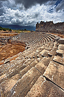 Ampitheatre of Xanthos that has been modified by the Romans with a wall around what would have been the stage to make a pit for Gladitorial & animal events. Xanthos UNESCO World Heritage Archaeological Site, Turkey