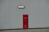 Daytime Landscape View Of A Red Service Door In A Motorway Underpass in Guangzhou, China.  © LAN