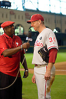 Philadelphia Phillies pitcher Roy Halladay #34 is interviewed by broadcaster Gary Matthews following the Major League Baseball game against the Houston Astros at Minute Maid Park in Houston, Texas on September 14, 2011. Philadelphia defeated Houston 1-0 to clinch a playoff berth.  (Andrew Woolley/Four Seam Images)