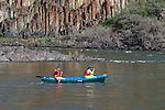 Howie Wallace (stern paddler) and Gordon Congdon on John Day River in central Oregon.  Basalt columns in background.<br />