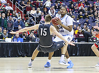 Washington, DC - March 11, 2018: Davidson Wildcats forward Oskar Michelsen (15) draws a charging foul from Rhode Island Rams forward Andre Berry (34) during the Atlantic 10 championship game between Rhode Island and Davidson at  Capital One Arena in Washington, DC.   (Photo by Elliott Brown/Media Images International)
