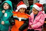 WATERBURY, CT-122117JS04---Students enjoy their new winter coats during a  giveaway Thursday at Bucks Hill School in Waterbury. 300 coats were given away to children from the Waterbury School District with help from the Waterbury Fire Department, and donor support from Cigna, MacDermid, Inc., and Brass Axe Capital and partnership with Operation Warm. Jim Shannon Republican-American