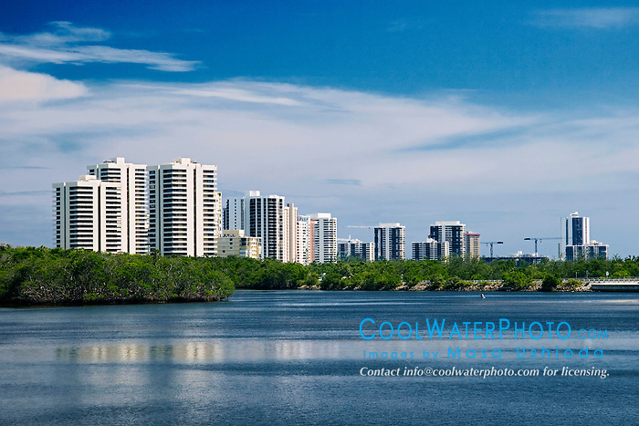 high-rise condominiums and hotels on Singer Island over Lake Worth, a preserved, pristine estuary, John D. MacArthur Beach State Park, North Palm Beach, Florida
