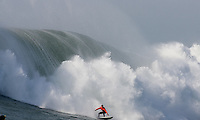 Mavericks 2010 Champion Chris Bertish rides a wave during the finals 2010 Mavericks Surf Contest in Half Moon Bay, California on February 13th, 2010.