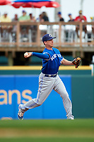 Toronto Blue Jays second baseman Andy Burns (1) throws to first during a Spring Training game against the Pittsburgh Pirates on March 3, 2016 at McKechnie Field in Bradenton, Florida.  Toronto defeated Pittsburgh 10-8.  (Mike Janes/Four Seam Images)